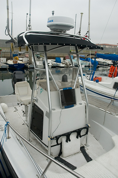 Photo: Solar panel rigged to front of console on Boston Whaler.